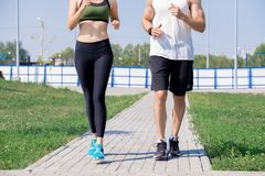 Young Couple Jogging Low Section stock photos