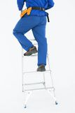 Low section of repairman climing ladder Royalty Free Stock Image