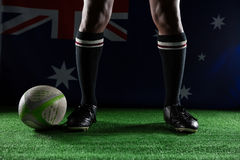Low section of rugby player standing against Australian flag Royalty Free Stock Photos