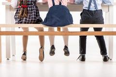 Schoolchildren studying at desk Royalty Free Stock Photos