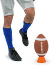 Low section of sports player being about to kick ball Royalty Free Stock Photos