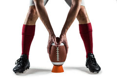 Low section of sports player placing the ball Royalty Free Stock Images
