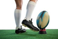 Low section of sportswoman kicking rugby ball stock photos