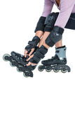 Low section of sporty woman wearing inline skates Stock Photo