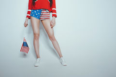 Low section of stylish hipster girl in american patriotic outfit isolated on grey. American culture concept Royalty Free Stock Image