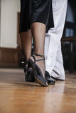 Low Section Of Tango Dancers Performing In Restaurant. Low section of male and female tango dancers performing in restaurant Royalty Free Stock Photos