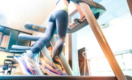Low section view of active sportswoman running on treadmill at gym fitness studio - Healthy lifestyle concept with woman. Exercising at running machine stock images