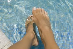 Low section view of a woman`s feet in a swimming pool royalty free stock photos