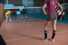 Low section of volleyball player with team holding ball Royalty Free Stock Images
