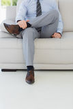 Low section of a well dressed relaxed young man Royalty Free Stock Image