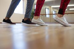 Low section of woman with friend rehearsing dance on floor Stock Images