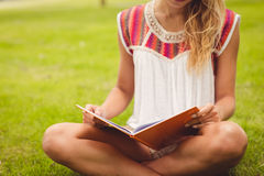 Low section of woman reading book Royalty Free Stock Image