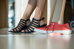 Low section of woman wearing black sandal Royalty Free Stock Photography