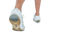 Low section of woman wearing sports shoe jogging Royalty Free Stock Photos