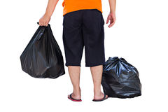 Low section of young man carrying garbage bags Stock Photo
