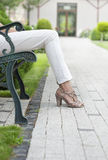 Low section of young woman relaxing on park bench Royalty Free Stock Photography