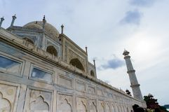 Low shot of the famous Taj Mahal. Low shot of the world famous Taj Mahal located in Agra. This shows off the staggering height and intricately designed marble Stock Photos