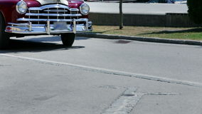 Low shot of front part of vintage car stock video footage