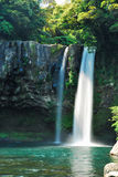 Low shot of majestic waterfall. Falling into blue pond Stock Images