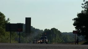 Low shot of traffic vehicles driving through the crossroad stock video footage