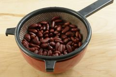 Low sodium kidney beans. Canned kidney beans in strainer to drain after rinsing with water to reduce sodium Stock Photography