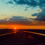 Low sun over railroad in sunset Stock Photo