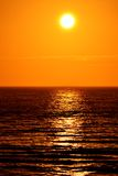 Low Sun Over the Sea. A photograph of the sun low over the ocean. Photographed In Blackpool, England Royalty Free Stock Photo