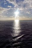 Low Sun Reflected in Dark Ocean Stock Image