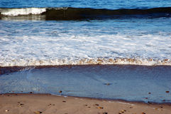 Low Surf. Small breakers in the morning on Ventura Beach, California Stock Photo