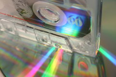 Low Tech. A transparent cassette standing on a CD Royalty Free Stock Photography