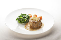 Juicy Fillet Mignon served with Sauce and Vegetables. Low temperature cooked Filet Mignon served on a juicy sauce with vegetables and white asparagus on top stock image