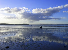 Low Tide. Reflection of clouds at low tide in Poole Harbour, Dorset royalty free stock image