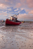Low tide. Fishing boat in low tide Royalty Free Stock Photography