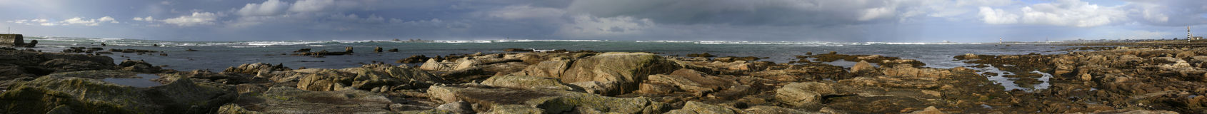 Low tide. Big stitched Panorama on a stormy day in France Stock Image