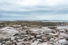 Low tide along Wonderland Trail coastline. Showing flat shelf, rocky bottom and tidepools stock photo