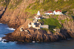 Low Tide at Amherst. Fort Amherst Newfoundland during Sunrise showing Lighthouse and Remains of Coastal Defense Gun Emplacements from two World Wars Stock Photo