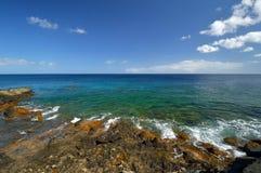 Low tide at the Atlantic Ocean coast. Lanzarote. Low tide at the Atlantic Ocean rocky coast. Charco del Palo, Lanzarote, Canary Islands, Spain Stock Photography