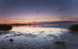 Low tide at a bathing place. Blurred people in the far distance. Wide angle photo Royalty Free Stock Images