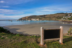 Low Tide at a bay at daylight. Empty signage. Royalty Free Stock Image