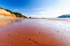 Low Tide in the Bay of Fundy reveals ocean floor. Five Islands Provincial Park: View of the Bay of Fundy at low tide Stock Images