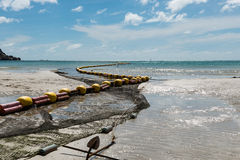 Low tide beach bouy line for swimming area. Bouy line for swimming area at Haad Rin, Koh Phangan, Thailand with clear blue sea and beautiful sky Royalty Free Stock Image