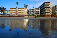 Low tide beach front at Sleepy Hollow, Laguna Beach, California. Image shows an extreme low tide during the winter months on the beach front at Sleepy Hollow stock photography