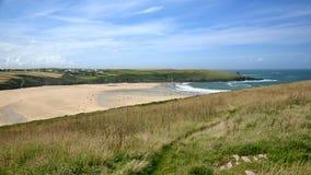 Low tide beach landscape: coast, deep blue skies. A beautiful sea or ocean coastal landscape view, Newquay, Cornwall, England, United Kingdom. Suitable as Royalty Free Stock Photo