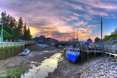 Low tide with boats. Low tide and boats on the ocean floor in a harbor Stock Photo