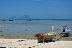 Low tide and boats in thailand. Low tide and boats on shore in ko mook island, thailand Royalty Free Stock Photography
