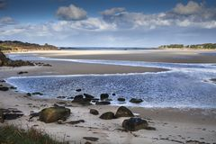 Low tide in Britanny, France on a sunny day, in a sandy peaceful Royalty Free Stock Photos