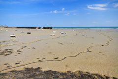 Low tide Brittany. Beautiful view of the French beach at low tide with boats on dry land in Cancale, France, in summer Stock Photography