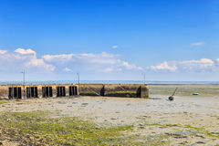 Low tide Cancale fishing port. Pier and boat. Brittany, France. Royalty Free Stock Photography