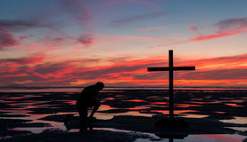 Low Tide Cross Praying Stock Photos