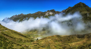 Low Tide. Fog over the mountain valley, Central Pyrenees, France Royalty Free Stock Images